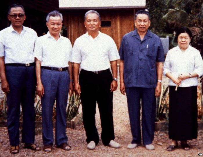 FILE - Pol Pot (2nd R), notorious leader of Cambodia's Khmer Rouge, is sh