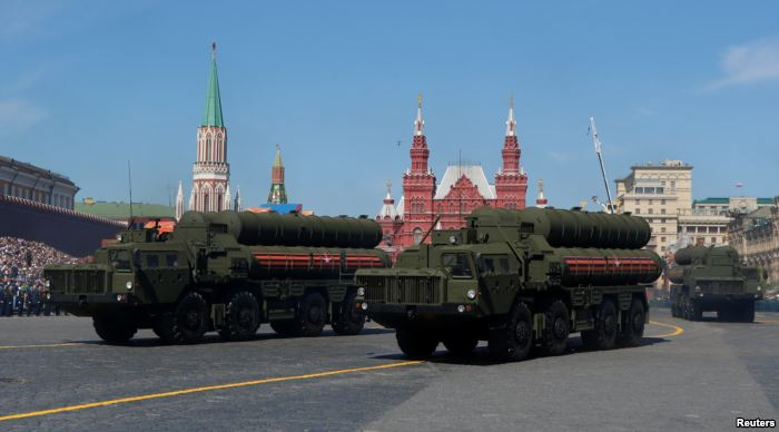 FILE - Russian servicemen drive S-400 missile air defense systems during the