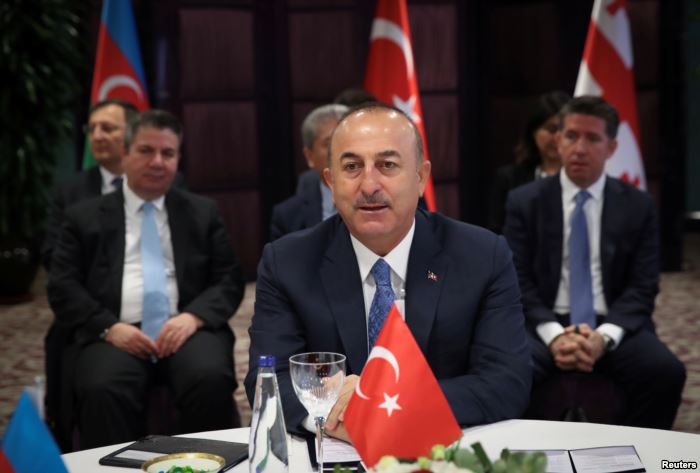 FILE - Turkish Foreign Minister Mevlut Cavusoglu speaks during a meeting in I