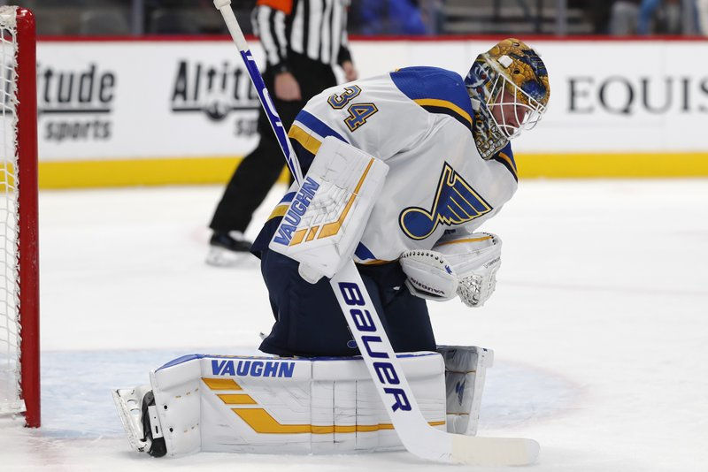 St. Louis Blues goaltender Jake Allen makes a glove save during the first period of the team's NHL hockey game against the Colorado Avalanche on Friday, Nov. 30, 2018, in Denver. (AP Photo/David Zalubowski)