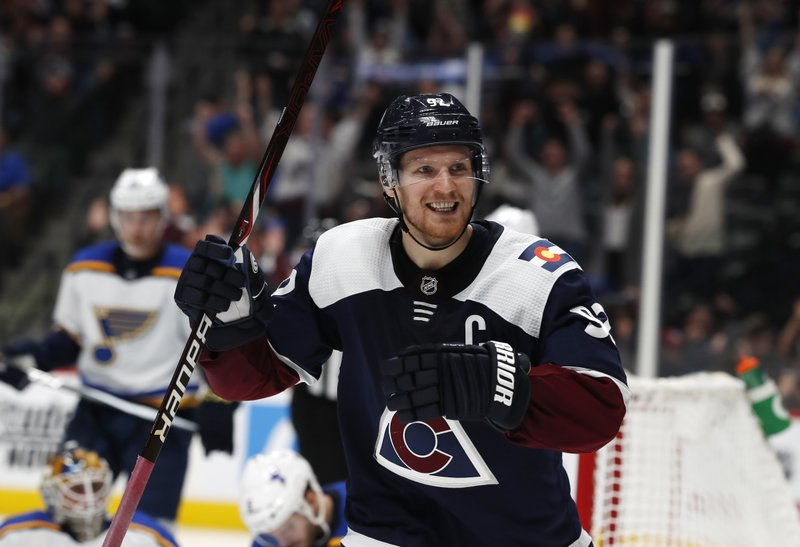 Colorado Avalanche left wing Gabriel Landeskog smiles after the Avalanche scored during the third period of the team's NHL hockey game against the St. Louis Blues on Friday, Nov. 30, 2018, in Denver. The Blues won 3-2 in overtime. (AP Photo/David Zalubowski)
