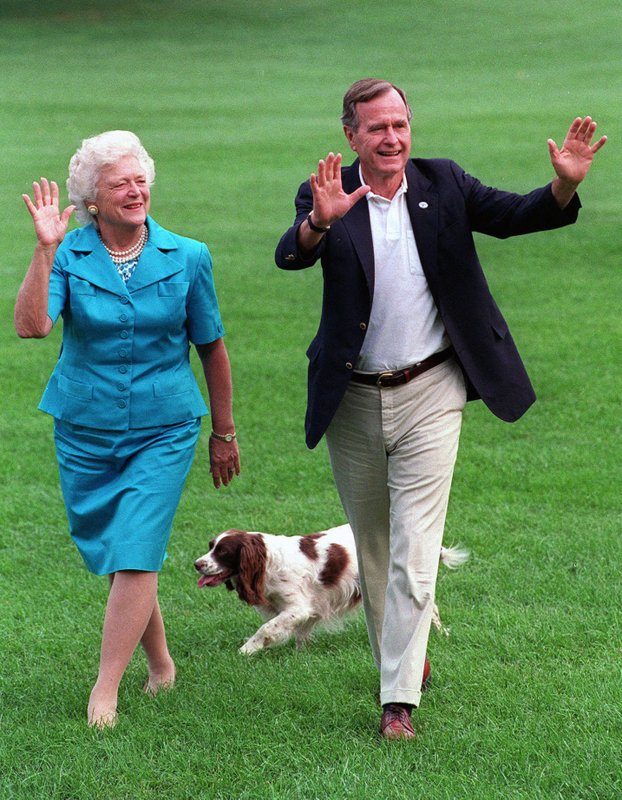 FILE - In this Aug. 24, 1992, file photo, President George H.W. Bush and first lady Barbara Bush walk with their dog Millie across the South Lawn as they return to the White House. Bush has died at age 94. Family spokesman Jim McGrath says Bush died shortly after 10 p.m. Friday, Nov. 30, 2018, about eight months after the death of his wife, Barbara Bush. (AP Photo/Scott Applewhite, File)