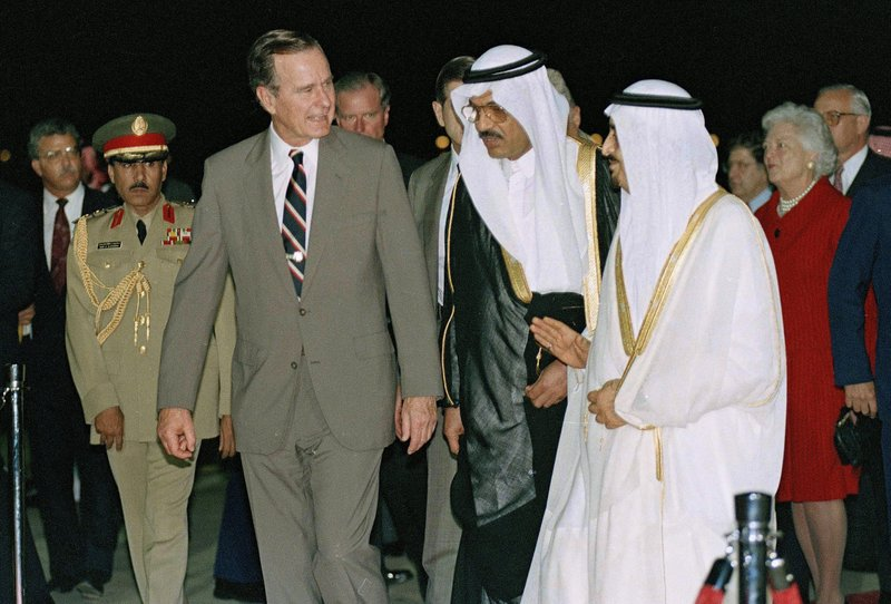 FILE - In this Nov. 21, 1990, file photo, President George H.W. Bush is greeted by King Fahd on his arrival in Jeddah, Saudi Arabia. At right is first lady Barbara Bush. Bush has died at age 94. Family spokesman Jim McGrath says Bush died shortly after 10 p.m. Friday, Nov. 30, 2018, about eight months after the death of his wife, Barbara Bush. (AP Photo/J. Scott Applewhite, File)