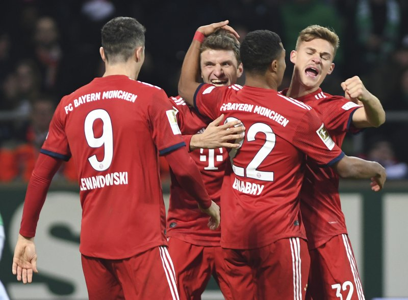 Bayern's Serge Gnabry, 2nd right, celebrates with team mates Robert Lewandowski, left, Thomas Mueller, 2nd left, and Joshua Kimmich, right, after scoring his side's second goal during the German Bundesliga soccer match between Werder Bremen and FC Bayern Munich in Bremen, Germany, Saturday, Dec. 1, 2018. (David Hacker/dpa via AP)