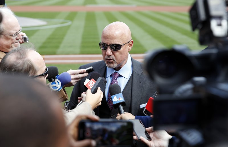 FILE - In this April 5, 2018 file photo, Washington Nationals general manager Mike Rizzo speaks during a media availability before the home opener baseball game against the New York Mets at Nationals Park in Washington. As much as the Nationals already have done to try to improve a team that flopped in 2018, one question will hover over their offseason until it's resolved: What is going to happen with Bryce Harper?  (AP Photo/Alex Brandon, File)