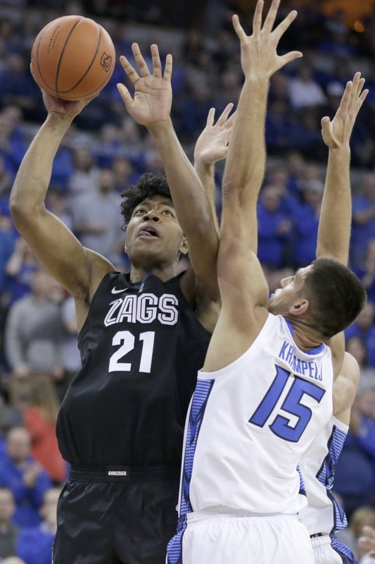 Gonzaga's Rui Hachimura (21) shoots to the basket against Creighton's Martin Krampelj (15) during the first half of an NCAA college basketball game in Omaha, Neb., Saturday, Dec. 1, 2018. (AP Photo/Nati Harnik)
