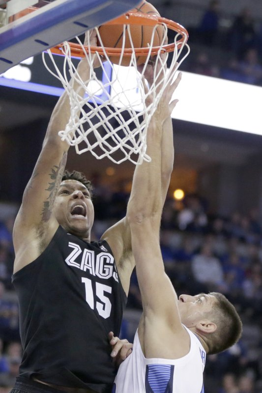 Gonzaga's Brandon Clarke (15) is fouled by Creighton's Martin Krampelj, right, during the first half of an NCAA college basketball game in Omaha, Neb., Saturday, Dec. 1, 2018. (AP Photo/Nati Harnik)