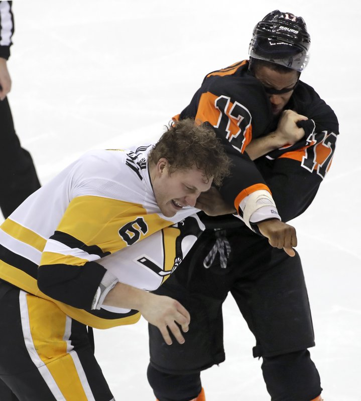 Pittsburgh Penguins' Jamie Oleksiak (6) and Philadelphia Flyers' Wayne Simmonds (17) fight during the first period of an NHL hockey game in Pittsburgh, Saturday, Dec. 1, 2018. (AP Photo/Gene J. Puskar)
