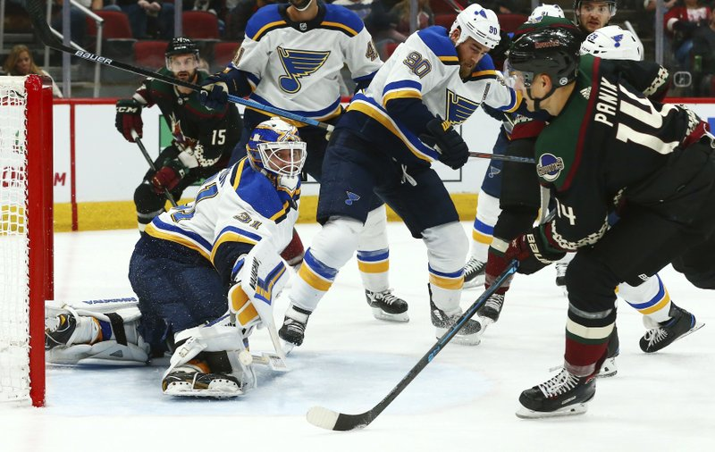 Arizona Coyotes right wing Richard Panik (14) sends the puck past St. Louis Blues goaltender Chad Johnson (31) and Blues center Ryan O'Reilly (90) for a goal during the second period of an NHL hockey game, Saturday, Dec. 1, 2018, in Glendale, Ariz. (AP Photo/Ross D. Franklin)