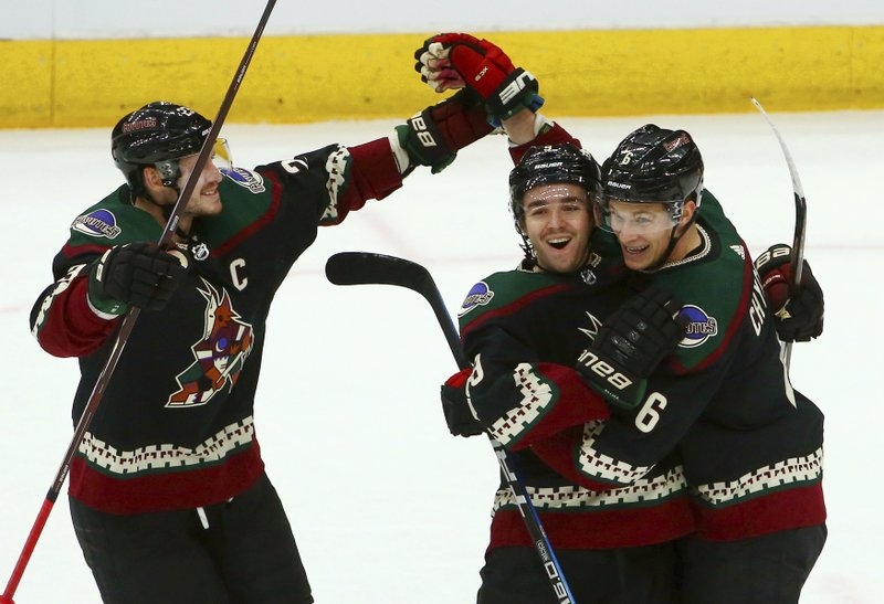 Arizona Coyotes defenseman Jakob Chychrun (6) celebrates his goal against the St. Louis Blues with Coyotes defenseman Oliver Ekman-Larsson, left, and center Clayton Keller, middle, during the first period of an NHL hockey game, Saturday, Dec. 1, 2018, in Glendale, Ariz. (AP Photo/Ross D. Franklin)