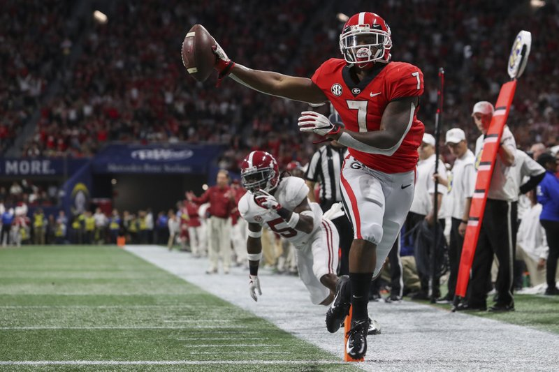 Georgia running back D'Andre Swift (7) runs into the end zone for a touchdown after a reception against Alabama during an NCAA college football game for the Southeastern Conference championship Saturday, Dec. 1, 2018, in Atlanta. (AJ ReynoldsAthens Banner-Herald via AP)