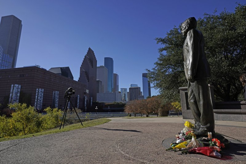 A statue of former President George H.W. Bush stands in downtown Houston, Sunday, Dec. 2, 2018. Bush is returning to Washington as a revered political statesman, hailed by leaders across the political spectrum and around the world as a man not only of greatness but also of uncommon decency and kindness.  Bush, died late Friday at his Houston home at age 94, is to be honored with a state funeral at National Cathedral in the nation's capital on Wednesday, followed by burial Thursday on the grounds of his presidential library at Texas A&M.(AP Photo/David J. Phillip)