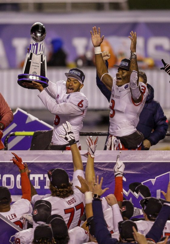 Fresno State quarterback Marcus McMaryion (6) celebrates with Mykal Walker (3) after an NCAA college football game against Boise State for the Mountain West championship, Saturday, Dec. 1, 2018, in Boise, Idaho. Fresno State won 19-16. (AP Photo/Steve Conner)