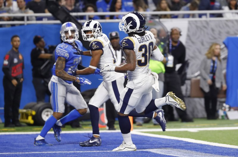 Los Angeles Rams running back Todd Gurley (30) runs into the end zone for a 13-yard rushing touchdown during the second half of an NFL football game against the Detroit Lions, Sunday, Dec. 2, 2018, in Detroit. (AP Photo/Paul Sancya)