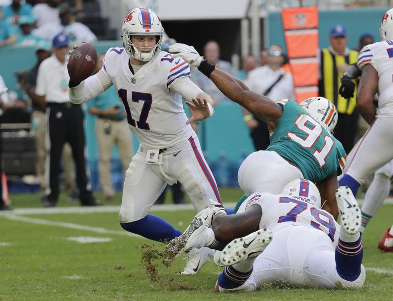 Buffalo Bills quarterback Josh Allen (17) avoids a tackle by Miami Dolphins defensive end Cameron Wake (91), during the second half of an NFL football game, Sunday, Dec. 2, 2018, in Miami Gardens, Fla. (AP Photo/Lynne Sladky)