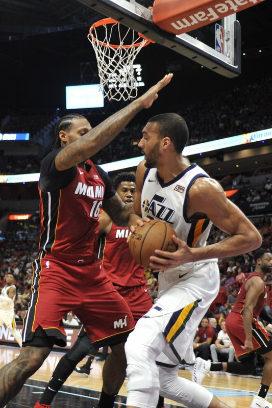 42f62402a61 Utah Jazz center Rudy Gobert (27) dribbles to the basket past the Miami Heat