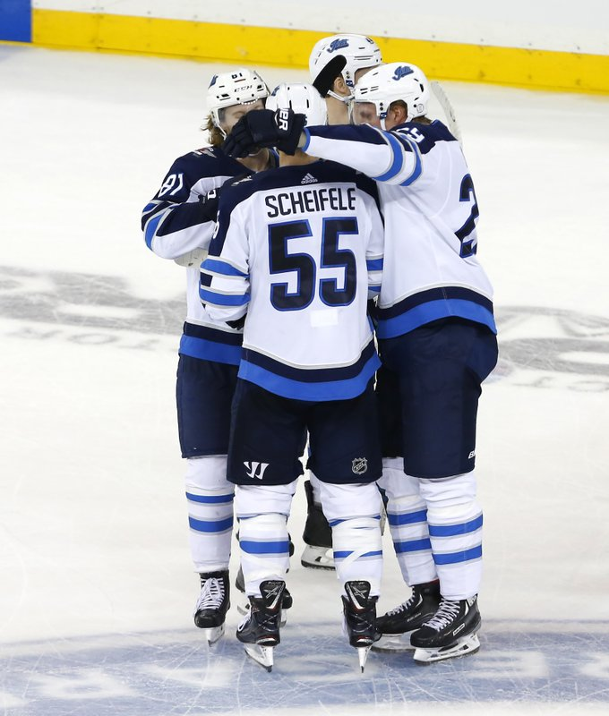 Winnipeg Jets center Mark Scheifele (55) celebrates after scoring the winning goal against the New York Rangers during a shoot out of an NHL hockey game, Sunday, Dec. 2, 2018, in New York. The Jets won 4-0. (AP Photo/Noah K. Murray)