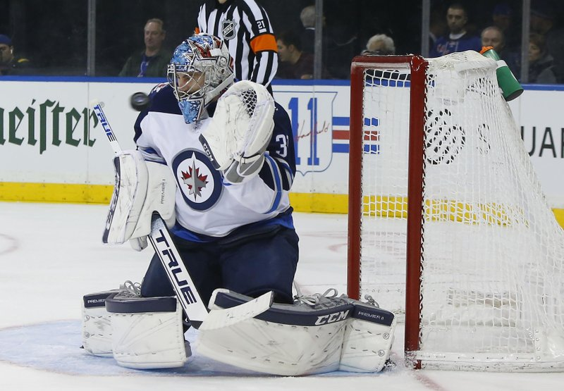 Winnipeg Jets goaltender Connor Hellebuyck (37) makes a save against the New York Rangers during the second period of an NHL hockey game, Sunday, Dec. 2, 2018, in New York. (AP Photo/Noah K. Murray)