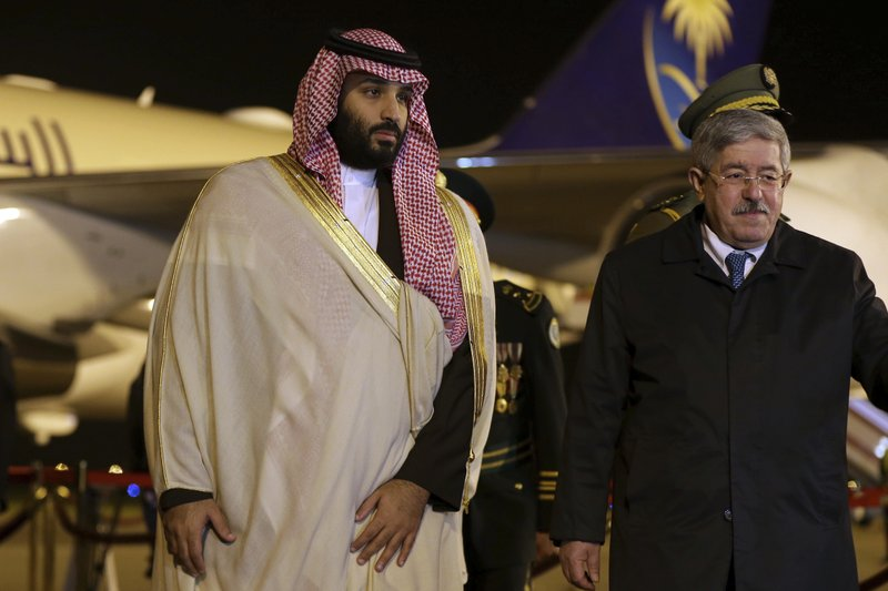 Saudi Crown Prince Mohammed bin Salman, left, is greeted by Algerian Prime Minister Ahmed Ouyahia upon his arrival at Algiers international airport, Algeria, Sunday, Dec. 2, 2018. Algeria's presidency says Saudi Crown Prince Mohammed bin Salman will start a two-day visit to Algeria Sunday with a focus on economic ties between the two countries. (AP Photo/Anis Belghoul)