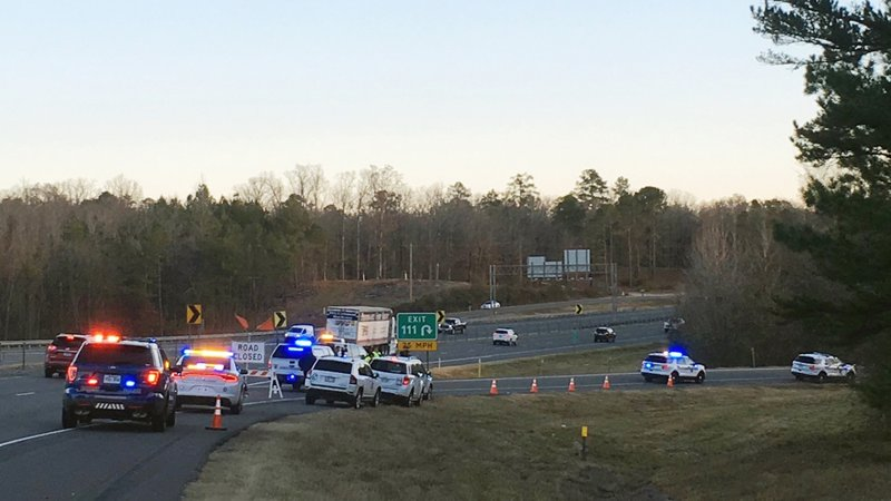 Emergency vehicles are parked along Interstate 30 near the scene where a charter bus that was carrying a youth football team from Tennessee crashed early Monday, Dec. 3, 2018, near Benton, Ark. The bus was carrying the team from Texas to Memphis, Tenn. (Josh Snyder/The Arkansas Democrat-Gazette via AP)