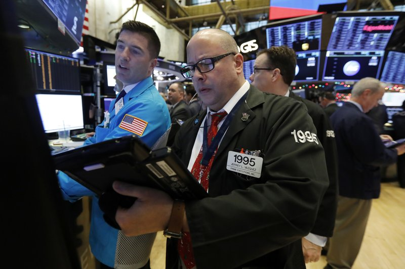 Specialist Thomas McArdle, left, and trader Jeffrey Vazquez work on the floor of the New York Stock Exchange, Monday, Dec. 3, 2018. Stocks are opening sharply higher on Wall Street, following gains in overseas markets after the U.S. and China struck a 90-day truce in their trade dispute. (AP Photo/Richard Drew)