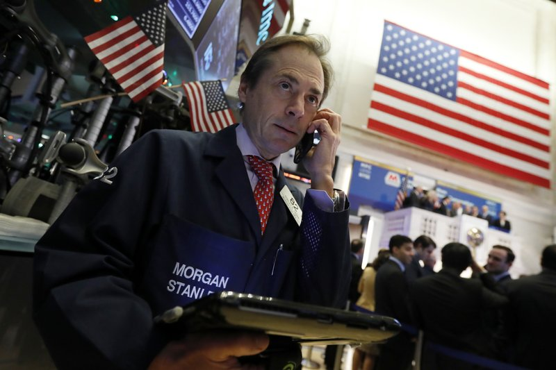 Trader Dudley Devine works on the floor of the New York Stock Exchange, Monday, Dec. 3, 2018. Stocks are opening sharply higher on Wall Street, following gains in overseas markets after the U.S. and China struck a 90-day truce in their trade dispute. (AP Photo/Richard Drew)