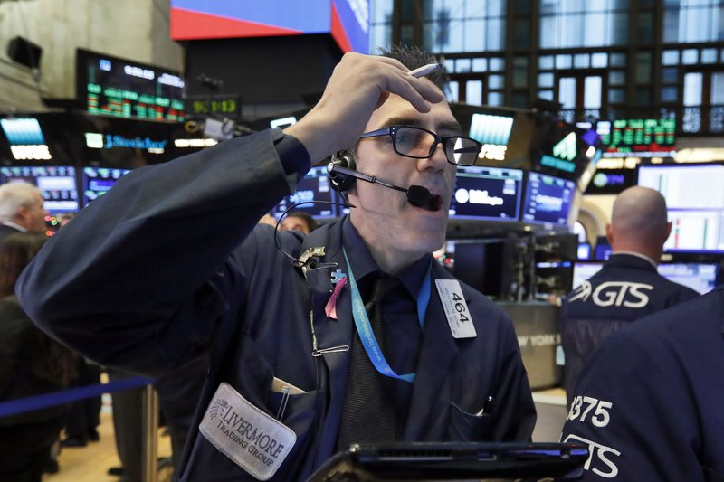 Trader Gregory Rowe works on the floor of the New York Stock Exchange, Monday, Dec. 3, 2018. Stocks are opening sharply higher on Wall Street, following gains in overseas markets after the U.S. and China struck a 90-day truce in their trade dispute. (AP Photo/Richard Drew)
