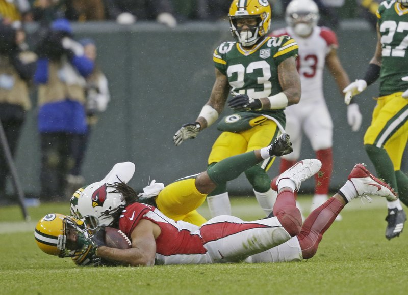 Arizona Cardinals wide receiver Larry Fitzgerald makes a diving catch for a first down late in the second half of an NFL football game against the Green Bay Packers Sunday, Dec. 2, 2018, in Green Bay, Wis. Arizona won 20-17. (AP Photo/Jeffrey Phelps)