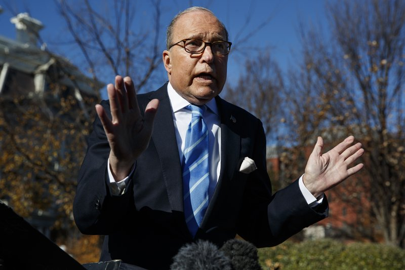 White House chief economic adviser Larry Kudlow talks with reporters about trade negotiations with China, at the White House, Monday, Dec. 3, 2018, in Washington. (AP Photo/Evan Vucci)