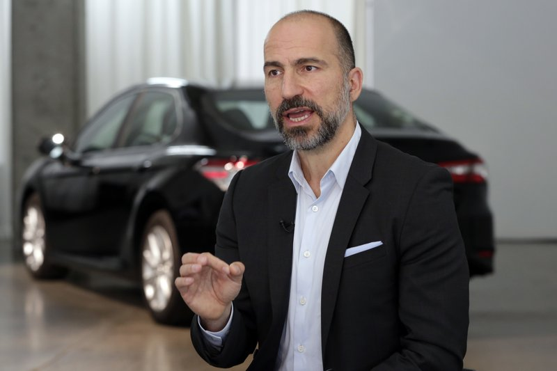 FILE - In this Sept. 5, 2018, file, photo, Uber CEO Dara Khosrowshahi speaks during an interview after the company unveiled new features in New York. Uber is launching a new minibus service on Tuesday, Dec. 4, 2018, in traffic-mad Cairo, Egypt's capital and the ride-sharing U.S. giant's fastest-growing market.  (AP Photo/Richard Drew, File)