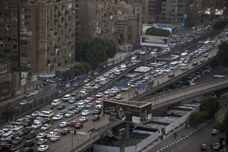 FILE - In this Oct. 7, 2013, file, photo, cars are bumper to bumper on a bridge in Cairo, Egypt. Uber is launching a new minibus service on Tuesday, Dec. 4, 2018, in traffic-mad Cairo, Egypt's capital and the ride-sharing U.S. giant's fastest-growing market.  (AP Photo/Hassan Ammar, File)