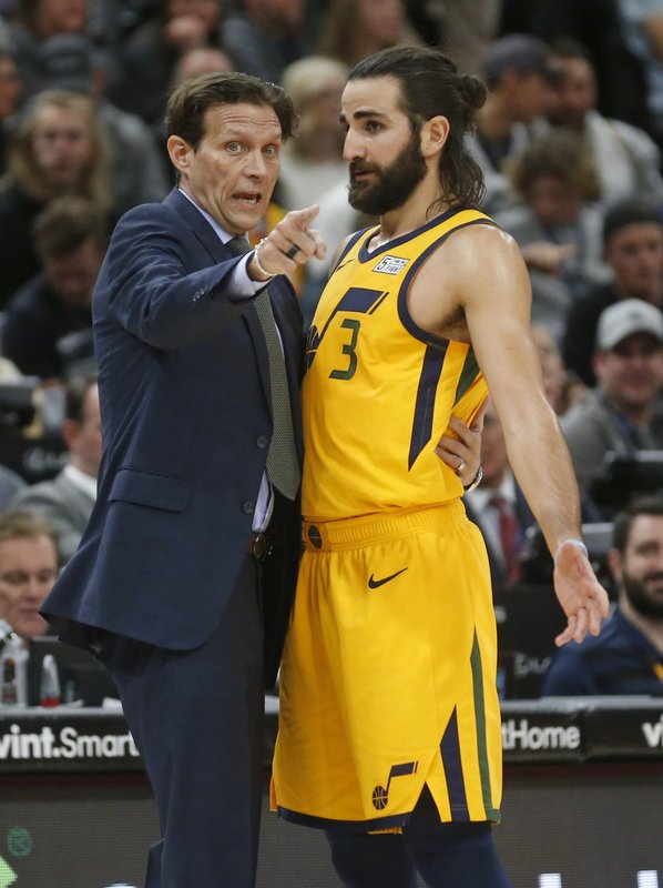 Utah Jazz head coach Quin Snyder speaks with guard Ricky Rubio (3) in the first half of an NBA basketball game, Tuesday, Dec. 4, 2018, in Salt Lake City. (AP Photo/Rick Bowmer)