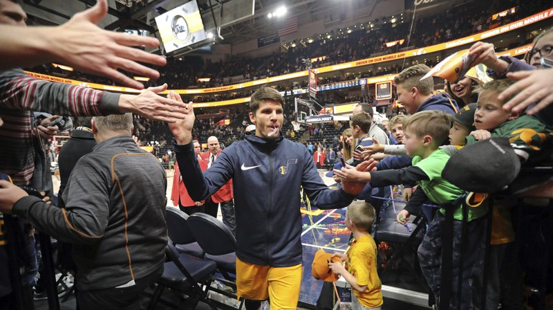 Fans reach for Utah Jazz guard Kyle Korver following their NBA basketball game against the San Antonio Spurs Tuesday Dec. 4, 2018, in Salt Lake City. (AP Photo/Rick Bowmer)