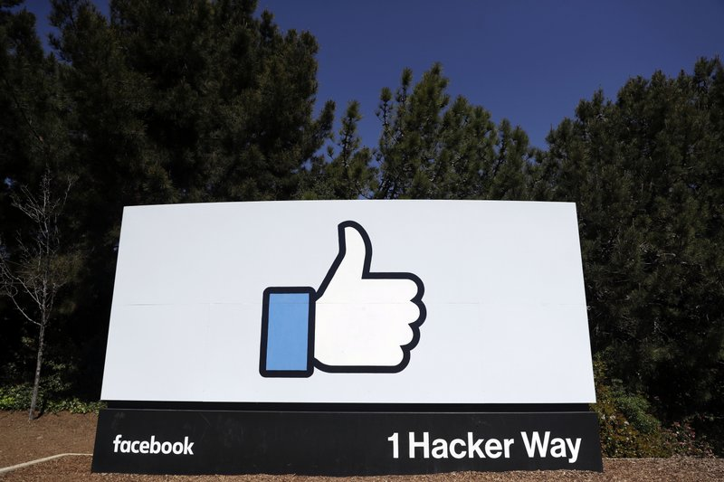 FILE- This March 28, 2018, file photo shows the Facebook logo at the company's headquarters in Menlo Park, Calif. The British Parliament has released some 250 pages worth of documents that show Facebook considered charging developers for data access. (AP Photo/Marcio Jose Sanchez, File)
