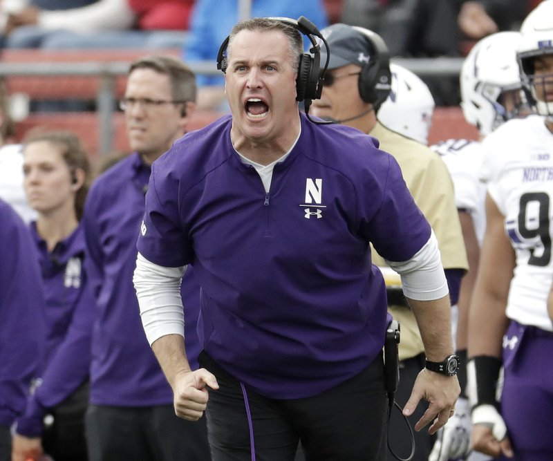FILE - In this Saturday, Oct. 20, 2018, file photo, Northwestern head coach Pat Fitzgerald talks to his team during the first half of an NCAA college football game against Rutgers, in Piscataway, N.J. Fitzgerald was named coach of the year when The Associated Press All-Big Ten Conference team was released Wednesday, Dec. 5, 2018.  (AP Photo/Julio Cortez, File)