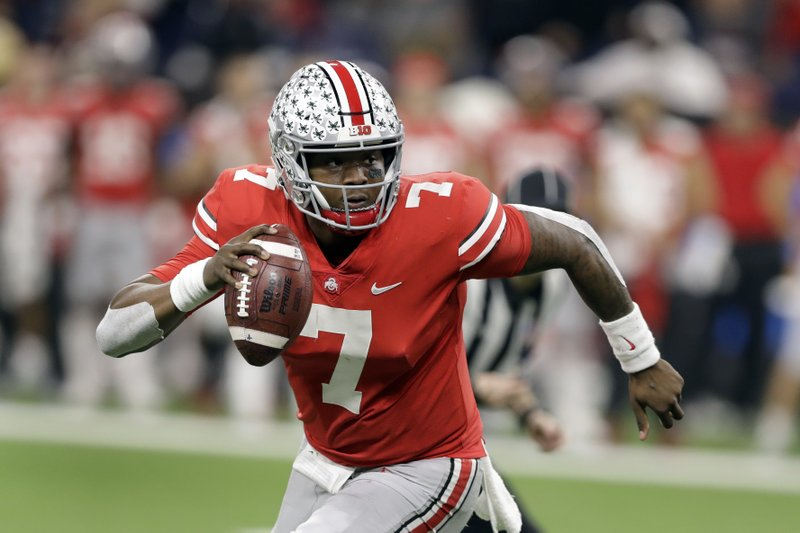 FILE - In this Dec. 1, 2018, file photo, Ohio State quarterback Dwayne Haskins (7) looks to throw during the first half of the Big Ten championship NCAA college football game against Northwestern, in Indianapolis. Haskins was named offensive player of the year when The Associated Press All-Big Ten Conference team was released Wednesday, Dec. 5, 2018. (AP Photo/Darron Cummings, File)