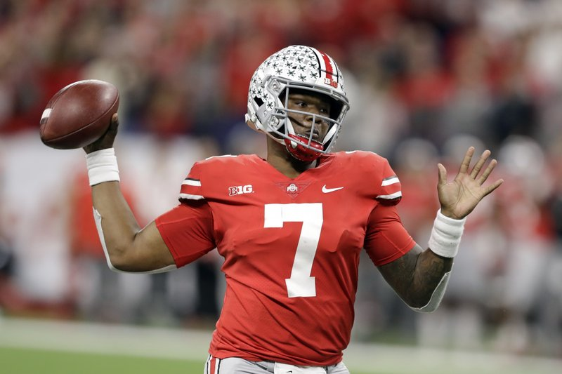 FILE - This Dec. 1, 2018, file photo shows Ohio State quarterback Dwayne Haskins (7) throwing during the first half of the Big Ten championship NCAA college football game against Northwestern, in Indianapolis. Haskins is the offensive player of the year and Michigan linebacker Devin Bush is defensive player of the year on The Associated Press All-Big Ten Conference team released Wednesday, Dec. 5, 2018. (AP Photo/Darron Cummings, File)