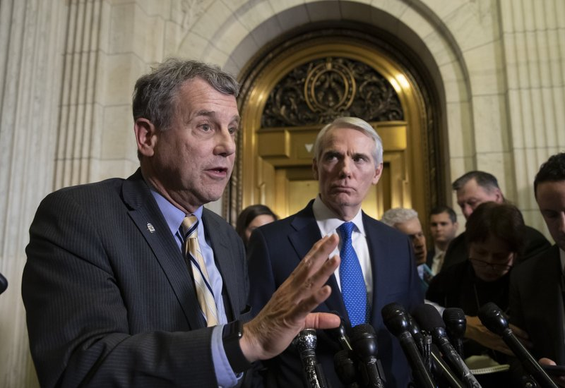 Sen. Sherrod Brown, D-Ohio, left, and Sen. Rob Portman, R-Ohio, speak to reporters after a meeting with General Motors CEO Mary Barra to discuss GM's announcement it would stop making the Chevy Cruze at its Lordstown, Ohio, plant, part of a massive restructuring for the Detroit-based automaker, on Capitol Hill in Washington, Wednesday, Dec. 5, 2018. (AP Photo/J. Scott Applewhite)