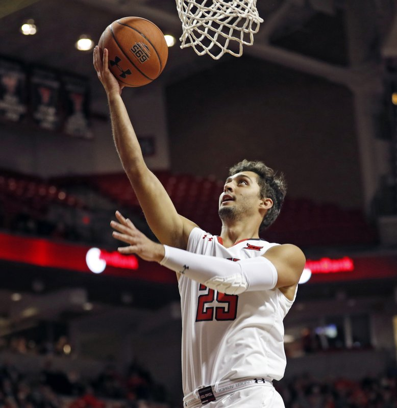 Texas Tech's Davide Moretti (25) lays up the ball during first half of an NCAA college basketball game against Arkansas-Pine Bluff, Wednesday, Dec. 5, 2018, in Lubbock, Texas. (AP Photo/Brad Tollefson)