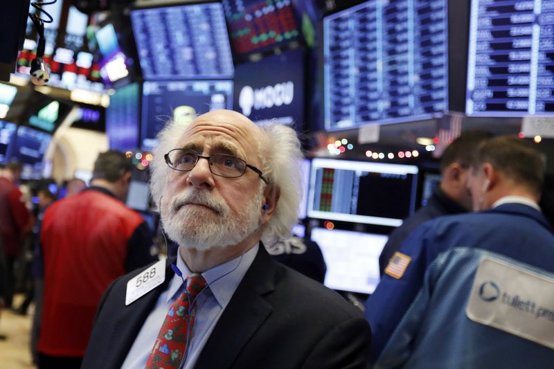 Trader Peter Tuchman works on the floor of the New York Stock Exchange, Thursday, Dec. 6, 2018. U.S. stocks tumbled in early trading Thursday following a sell-off in overseas markets. (AP Photo/Richard Drew)