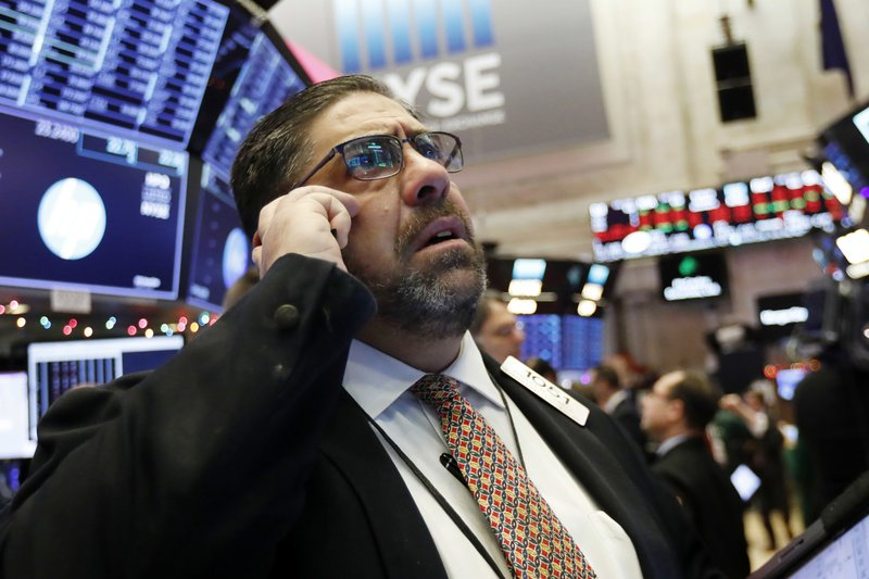 Trader Robert Oswald works on the floor of the New York Stock Exchange, Thursday, Dec. 6, 2018. U.S. stocks tumbled in early trading Thursday following a sell-off in overseas markets. (AP Photo/Richard Drew)