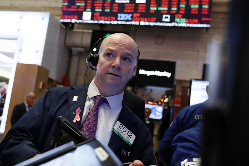 Trader Patrick Casey works on the floor of the New York Stock Exchange, Thursday, Dec. 6, 2018. U.S. stocks tumbled in early trading Thursday following a sell-off in overseas markets. (AP Photo/Richard Drew)