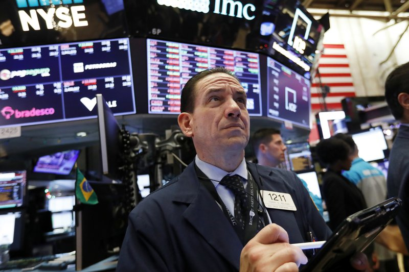Trader Tommy Kalikas works on the floor of the New York Stock Exchange, Thursday, Dec. 6, 2018. U.S. stocks tumbled in early trading Thursday following a sell-off in overseas markets. (AP Photo/Richard Drew)