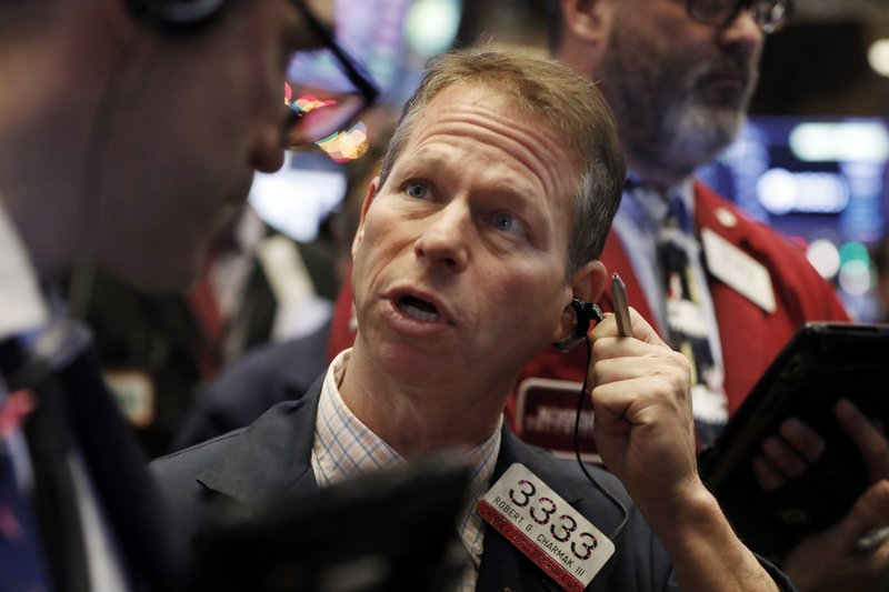 Trader Robert Charmak works on the floor of the New York Stock Exchange, Thursday, Dec. 6, 2018. U.S. stocks tumbled in early trading Thursday following a sell-off in overseas markets. (AP Photo/Richard Drew)