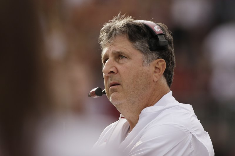 FILE - In this Sept. 29, 2018, file photo, Washington State head coach Mike Leach looks on during the first half of an NCAA college football game against Utah in Pullman, Wash. Leach was named the Pac-12 coach of the year Thursday, Dec. 6, 2018. (AP Photo/Young Kwak, File)