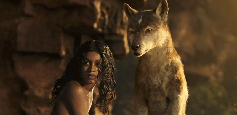 This image released by Netflix shows Rohan Chand as Mowgli, left, and the character Nishi, voiced by Naomie Harris, in a scene from the film,