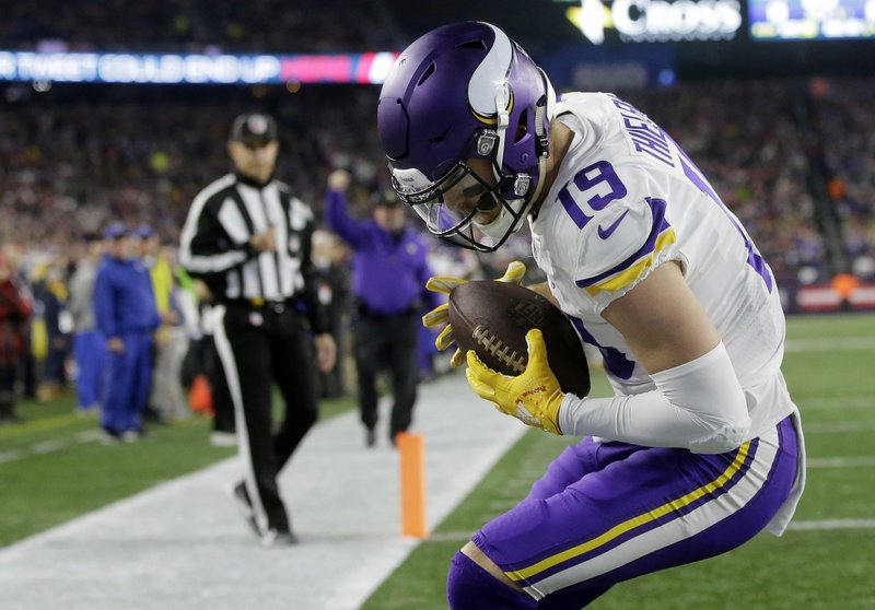 FILE - In this Dec. 2, 2018, file photo, Minnesota Vikings wide receiver Adam Thielen catches a touchdown pass against the New England Patriots during the first half of an NFL football game in Foxborough, Mass. Minnesota wide receivers Thielen and Stefon Diggs are the only receiver duo in the NFC each with more than 80 catches. Thielen has 98 receptions and Diggs has 84. (AP Photo/Steven Senne, File)