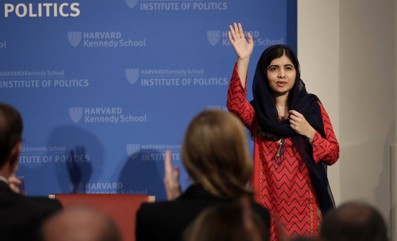 2014 Nobel Laureate Malala Yousafzai waves as she is introduced prior to addressing a gathering at the Kennedy School's Institute of Politics at Harvard University, Thursday, Dec. 6, 2018. (AP Photo/Charles Krupa)