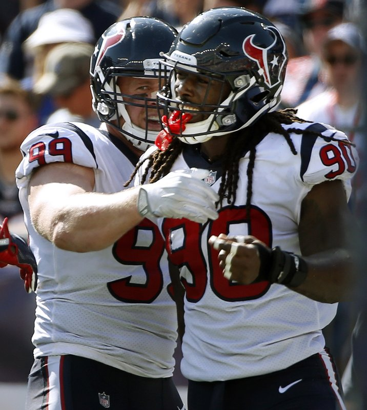 FILE - In this Sept. 24, 2017, file photo, Houston Texans linebacker Jadeveon Clowney, right, celebrates his touchdown with J.J. Watt, left, after recovering a fumble by New England Patriots quarterback Tom Brady during the first half of an NFL football game in Foxborough, Mass. Here's a crazy thought: The Houston Texans with home-field advantage throughout the AFC playoffs. Yep, the team that began the season 0-3 just might sneak past the Chiefs and Patriots and claim that coveted spot(AP Photo/Michael Dwyer, File)
