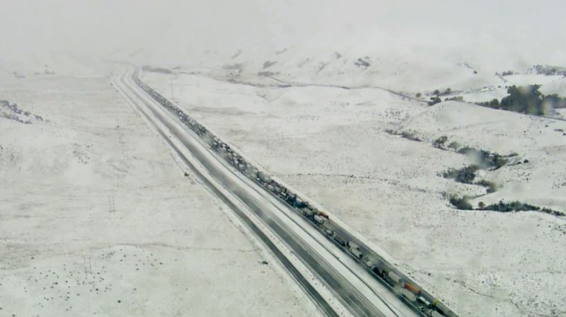 This aerial photo taken from video provided by KABC-TV shows traffic at a standstill on Interstate 5 near Gorman, Calif. (KABC-TV via AP)
